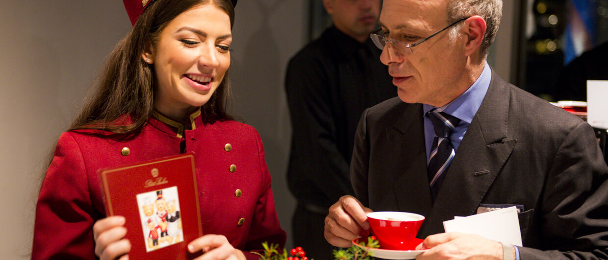 journalist and writer Alan Behr learns about the Hotel Sacher's superb services while sipping some Austrian coffee