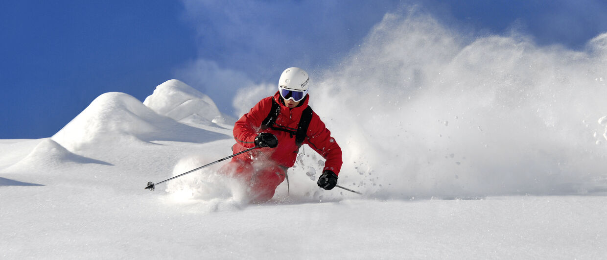 Deep powder snow skiing
